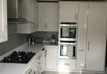 this was a dark wood kitchen before we hand painted using a little green paint Co oil based eggshell