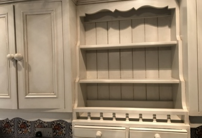 kitchen units with an antique paint effect